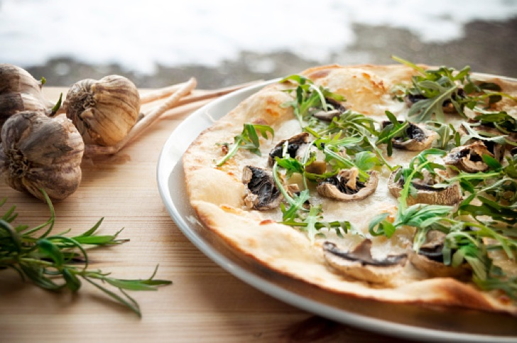 Close-Up Of Truffle Pizza Served In Plate On Table