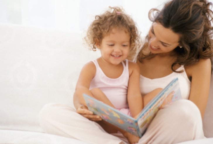 Mother reading book to daughter (2-4)