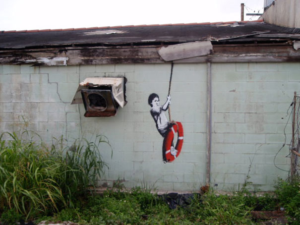 banksy-graffiti-street-art-boy-on-lifebuoy