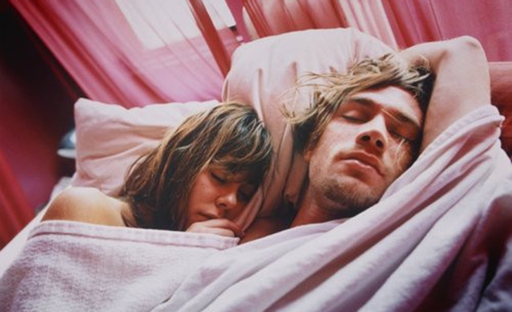 Young Couple Sleeping in Bed --- Image by © Glenn Glasser/Corbis