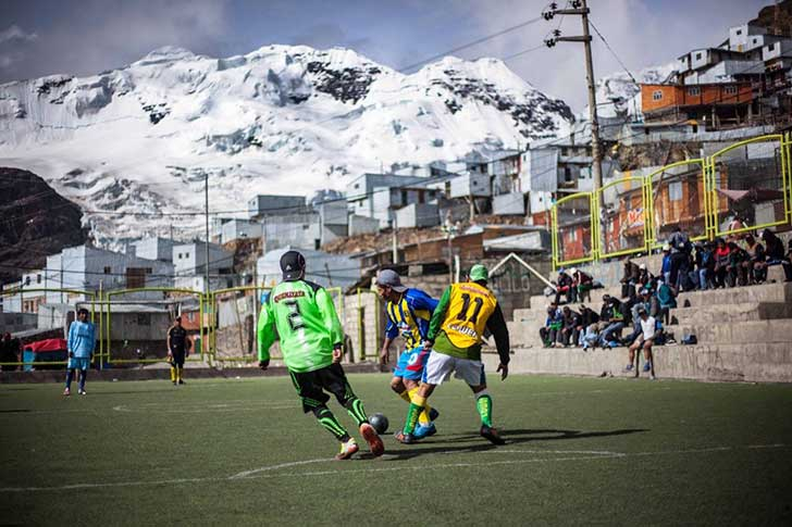 locals-have-to-find-old-fashioned-ways-of-entertaining-themselves-and-often-meet-in-cafs-built-for-the-miners-this-picture-taken-by-walker-dawson-shows-the-local-soccer-team-put-together-by-the-miners