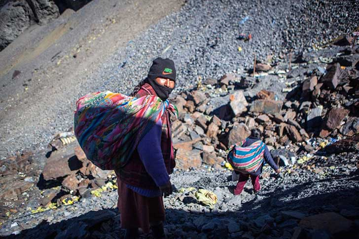 the-town-is-accessible-only-by-braving-a-precarious-mountainside-road-covered-in-grass-rocks-dirt-and-often-ice-the-journey-can-take-several-days