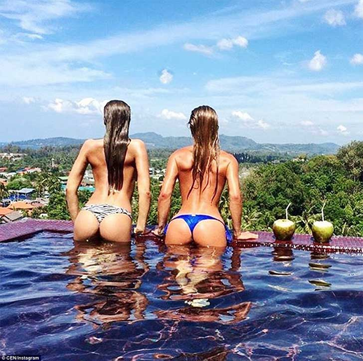3173920900000578-0-Two_girls_pose_in_their_bikinis_next_to_a_pool_in_what_looks_to_-a-145_1456161829670