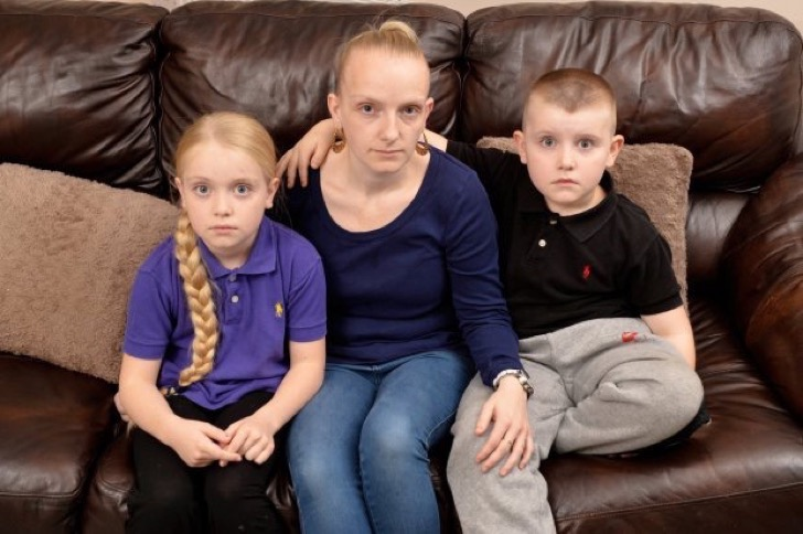 Pictured (L-R); Kasta (9), mum Keegan, Kydon (7). A single mum-of-six says two of her children have been without an education for over a YEAR - because she cannot find them a suitable school place. See NTI story NTISCHOOL. Unemployed Keegan Bradley ,30, originally had two of her kids booted out of school after claiming she couldn't afford to pay their bus fare. She said her £500-a-month child benefits could not cover the cost of getting Kasta (9), and Kydon (7), to lessons on public transport after she moved house. Keegan and her children, including Klissaya (5), K-laya (4), Konan (18 months) and Keon (4 months), moved to a four-bedroom house in Radford, Nottingham last October. They originally lived in Kirkby-in-Ashfield, Notts., which is around 15 miles away. Keegan had wanted all of her children to go to Mellers Primary School, in Radford, but only K-laya was accepted. Meanwhile, Klissaya remains at Jeffries Primary School, in Kirkby-in-Ashfield, where she stays with her grandmother four days a week. But Kasta and Kydon were expelled from Jeffries Primary School - after they missed over 20 days of term. It means her two eldest children have been without education for more than a year and now Keegan claims she cannot get them a place at a suitable school.