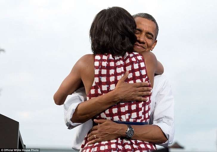 3a3f8f7c00000578-3926100-august_15_2012_the_president_hugs_the_first_lady_after_she_had_i-a-16_1478871703716-2